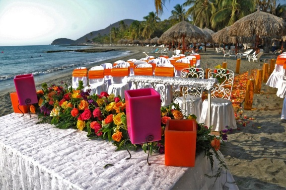 Exotic caribbean beach wedding with trendy pink and orange colors